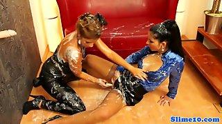 Bukakke lesbos toying pussy at the gloryhole
