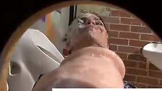Babe drenched in cum at a gloryhole