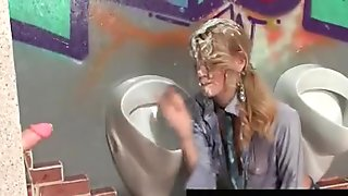Blond slut blows cock through gloryhole