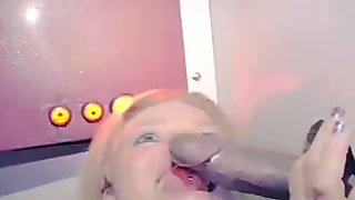 Blonde Taking Big Facial Cumshot From Black Dick Through Hole