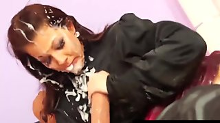 Bukkake lesbian gets sprayed by femdom
