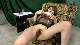 Dirty oriental in mesh plays with her bushy cunt